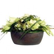 Arrangement of cut flowers with bowl